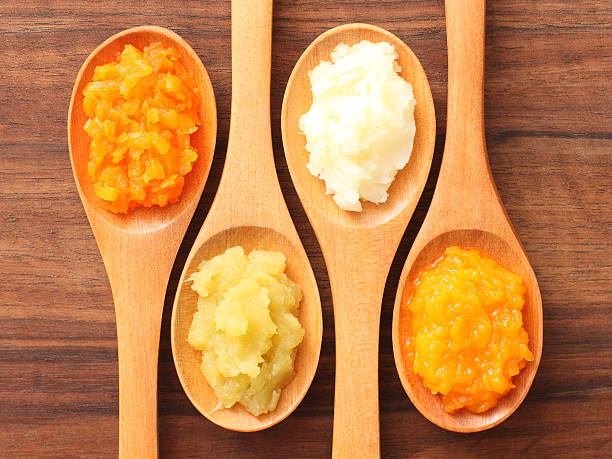 spoons and purees - mash food state stock photos and pictures