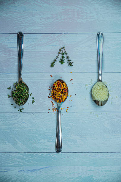 3 spoons with chilli and seeds stock photo