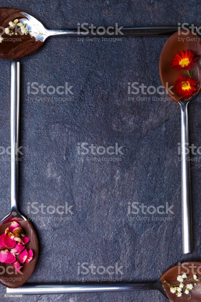 Spoons with frozen chocolate in the shape of a square close-up stock photo