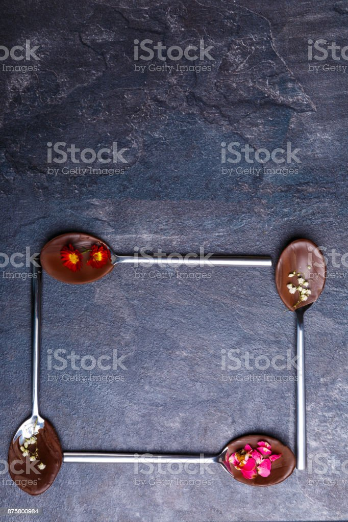Spoons with frozen chocolate, spoons lies in the form of a square bottom stock photo