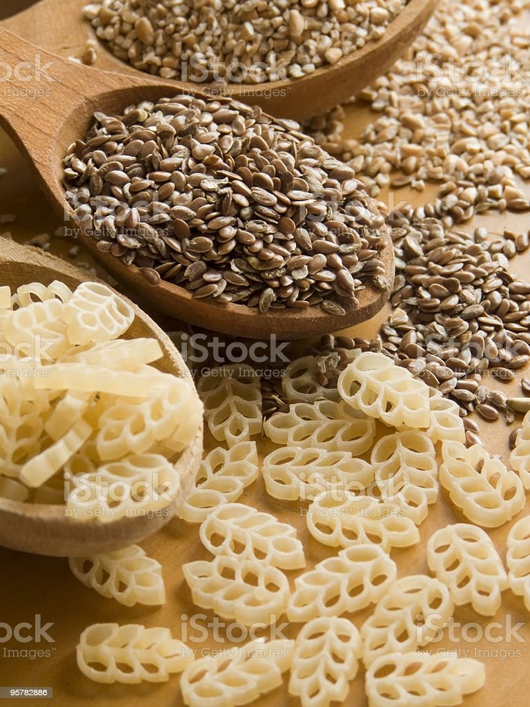 Spoons with groats royalty-free stock photo