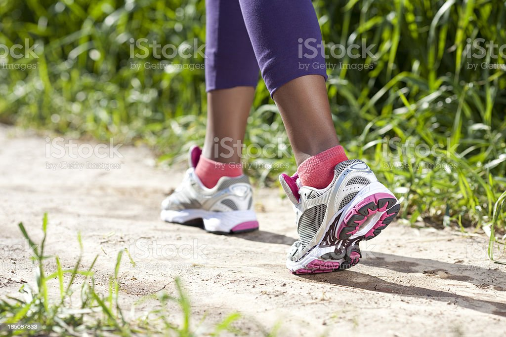 Sport activity-woman running outdoors. stock photo