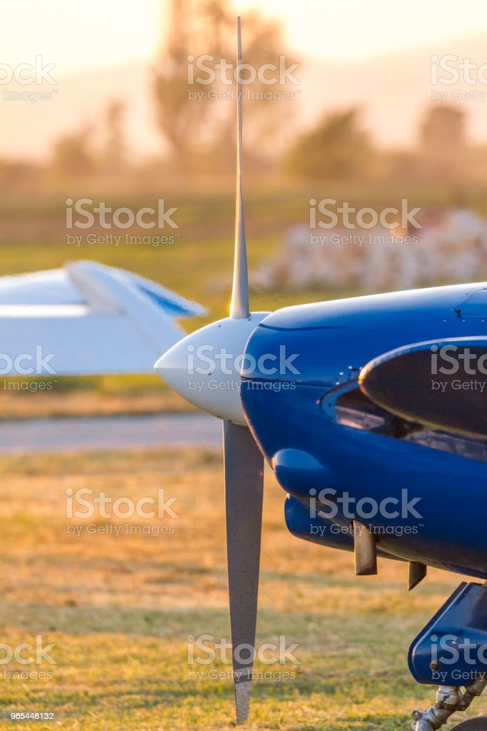 Sport airplane on blue propeller close up detailed on airfield in exhaust air mist. Concept for summer adventures vacation getaway travel and leisure holiday royalty-free stock photo