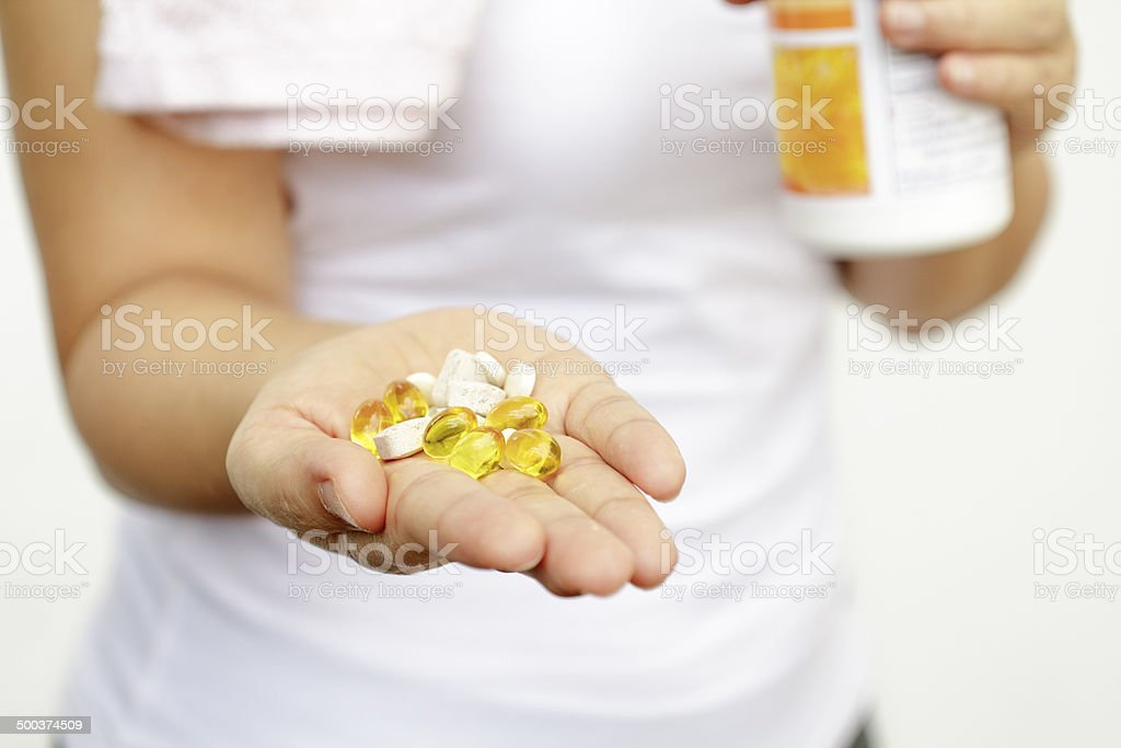 sport and diet concept - woman hand with medication stock photo