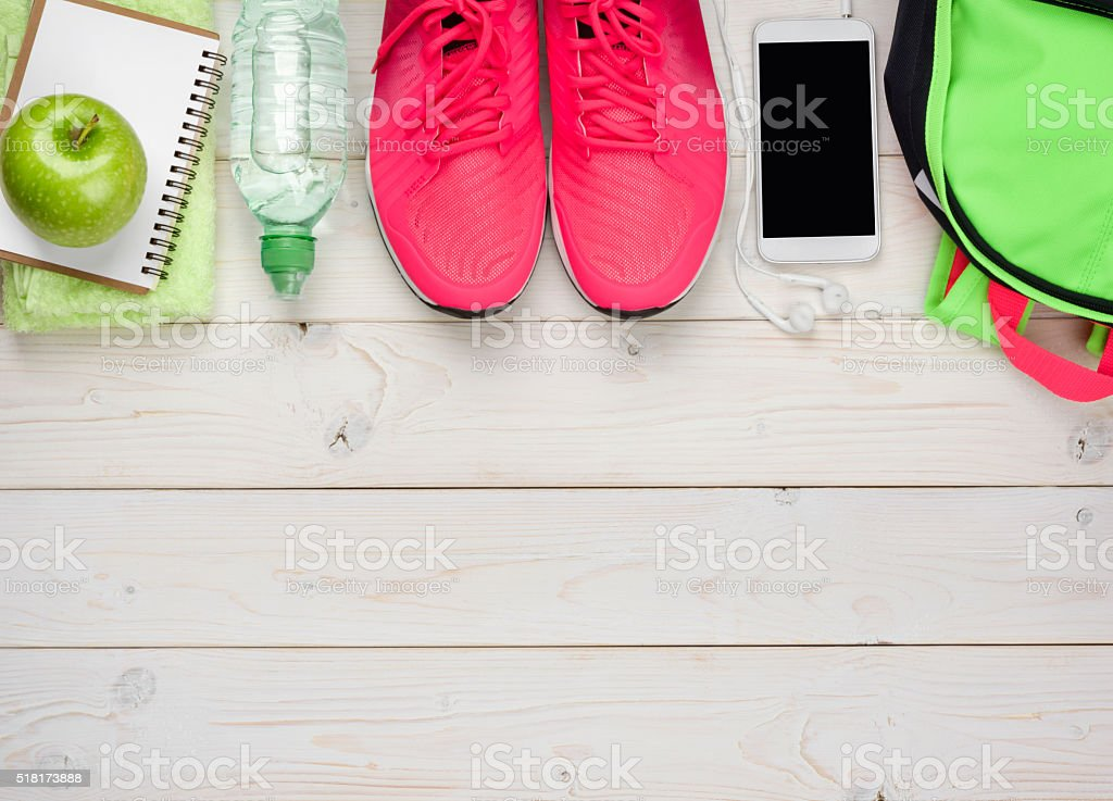 Sport and fitness concept on wooden planks background stock photo