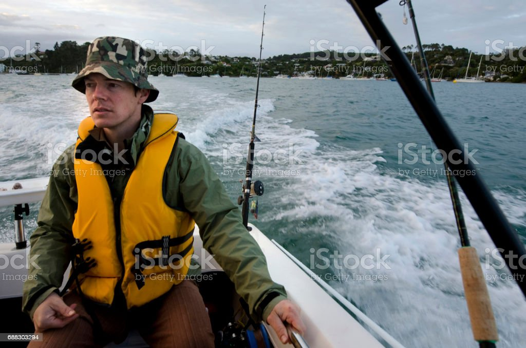 A young fisherman on a fishing journey at sea.