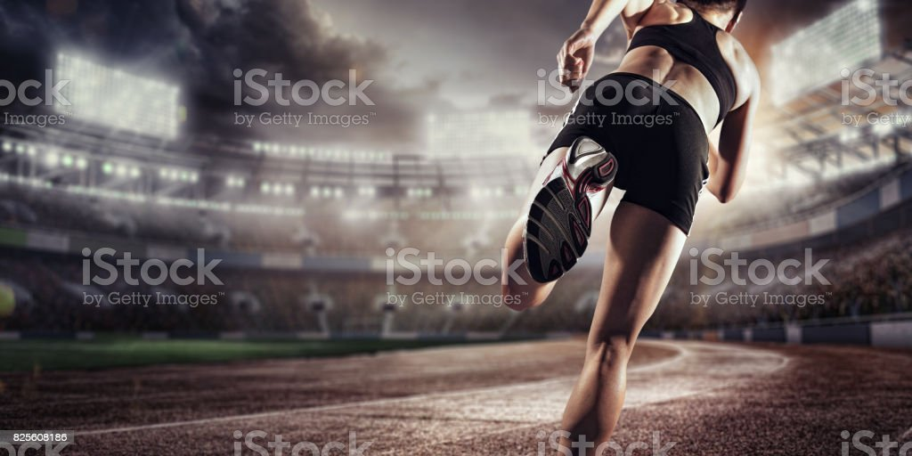 Sport background. Runner on the stadium. Dramatic scene. Back view. stock photo