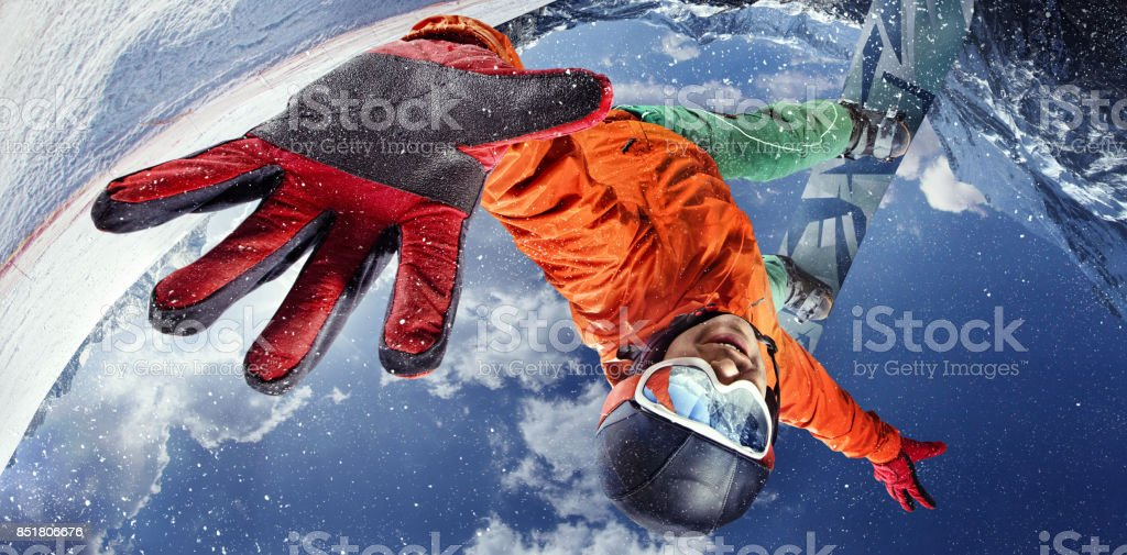 Sport background. Winter sport. Snowboarder jumping through air with deep blue sky in background. Top view stock photo