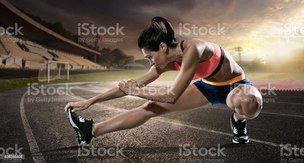 Sport backgrounds. Runner. Stretching before the stadium. stock photo