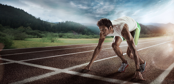 istock Sport backgrounds. Sprinter starting on the running track. Dramatic image. 826255430