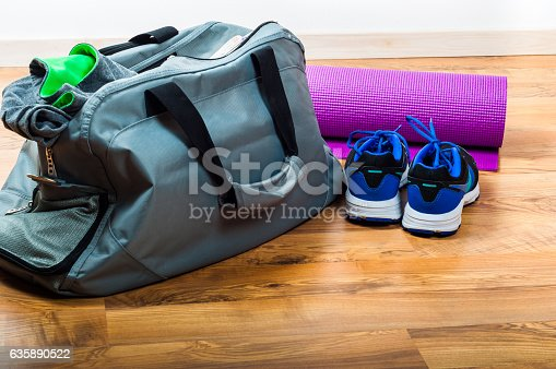 istock Sport bag on the wooden floor 635890522