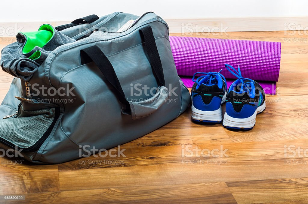 Sport bag on the wooden floor stock photo