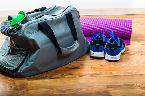 Sport bag on the wooden floor - Photo