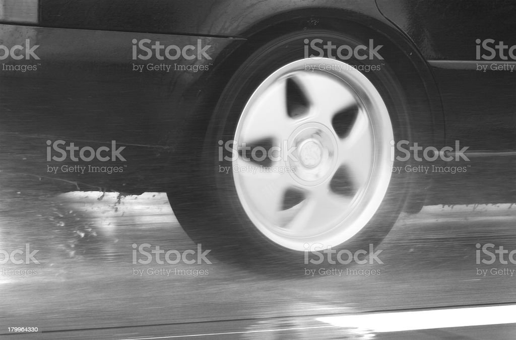 sport car driving fast in a rainy day royalty-free stock photo