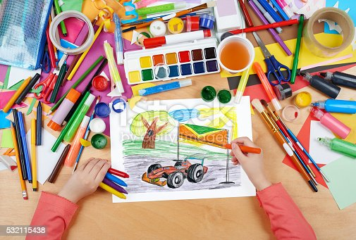istock sport car racing child drawing, top view hands 532115438