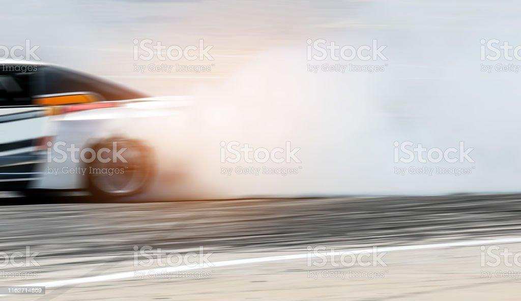 Sport car wheel drifting. Blurred of image diffusion race drift car...