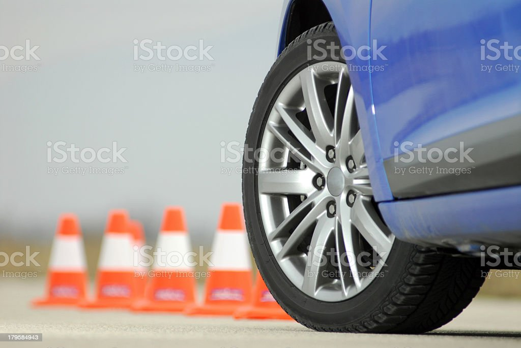 Sport car wheel with orange cones in background stock photo