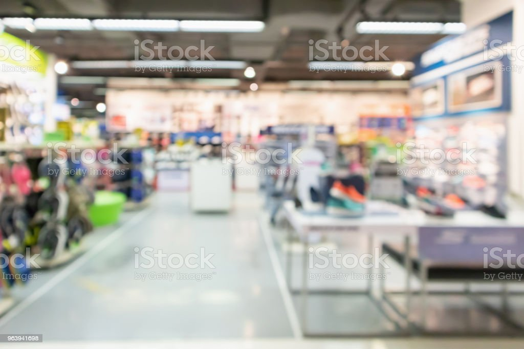 sport clothing store department in shopping mall blur defocused background - Royalty-free Abstract Stock Photo