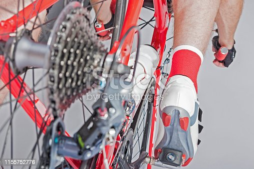Sport Cycling Concepts. Back View of the Athlete Leg Inline with Rear Derailleur and Cassette Sprokets. Back View. Horizontal Image