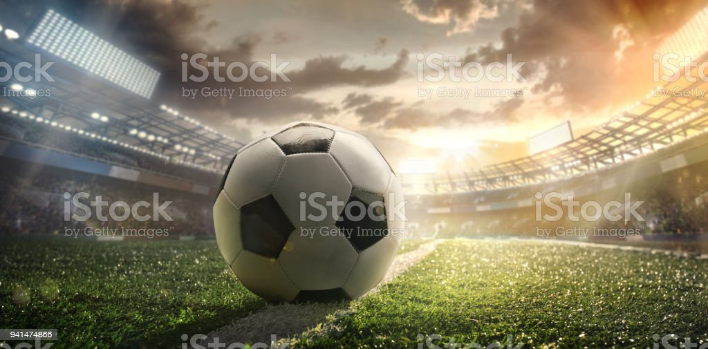 Sport. Empty football soccer field with white marks, green grass texture and soccer ball. stock photo