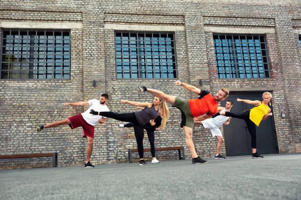 Sport enthusiasts exercising leg kicks stock photo