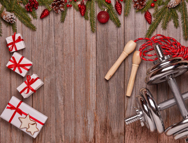 Sport equipment and Christmas decorations. Fitness. stock photo