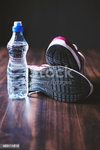 istock Sport equipment on wooden background 466414816