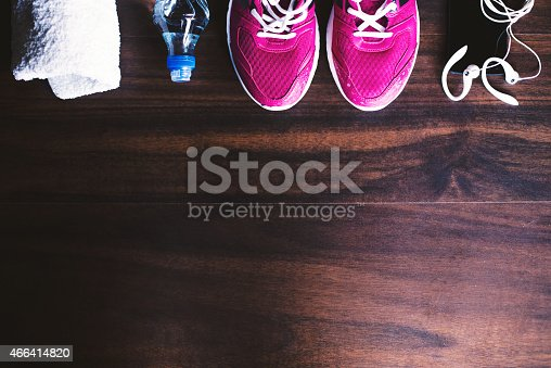istock Sport equipment on wooden background 466414820
