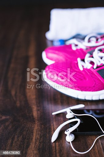 istock Sport equipment on wooden background 466429080