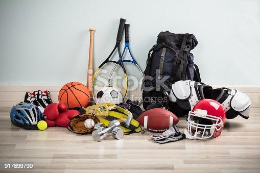 istock Sport Equipments On Floor 917899790