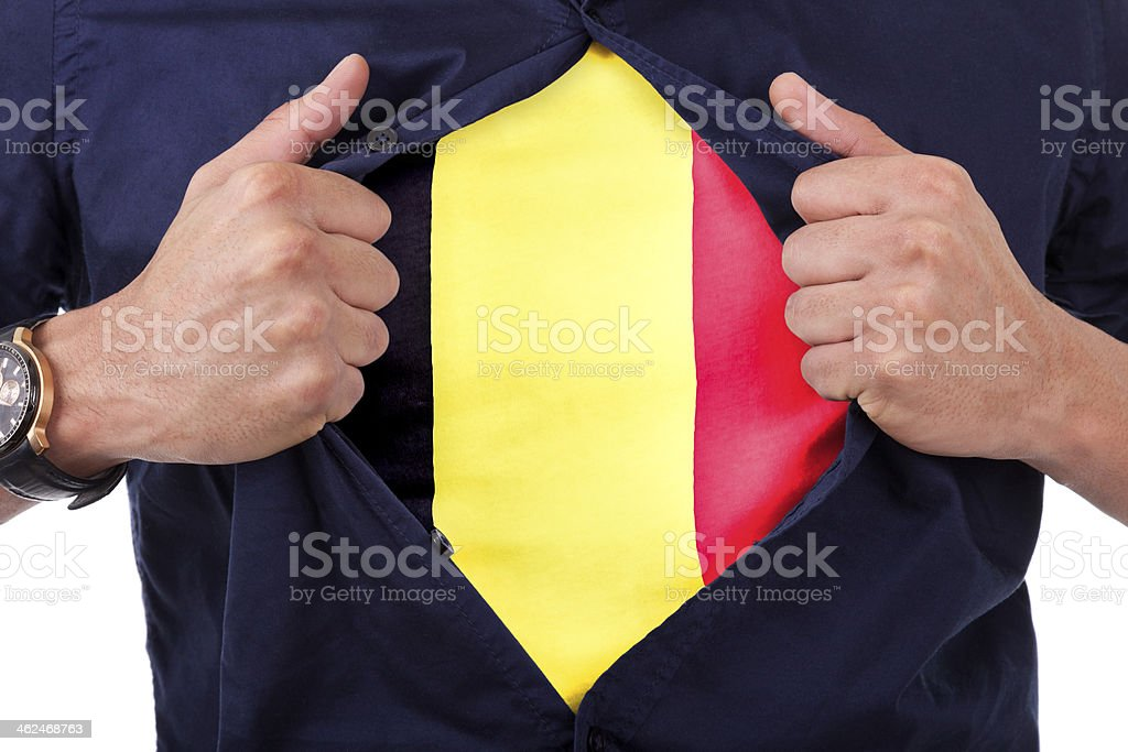 Sport fan opening his shirt and showing the belgian flag​​​ foto