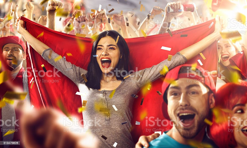 Sport fans: A girl holds a flag in her hands stock photo