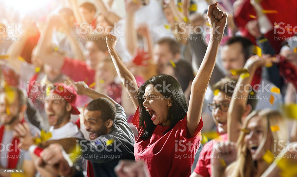 Sport fans: A girl shouting stock photo