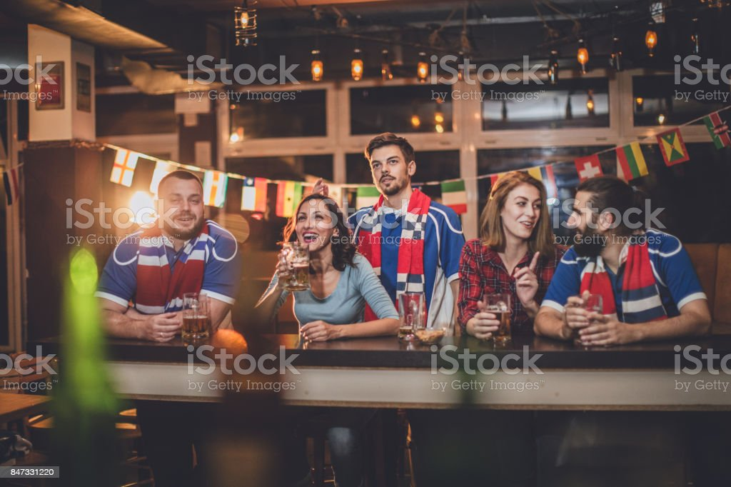 Sport fans at the bar stock photo