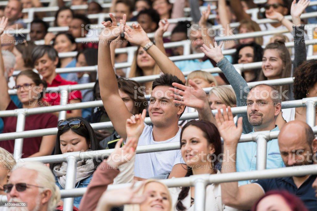 Sport Fans Cheering On Tribunes