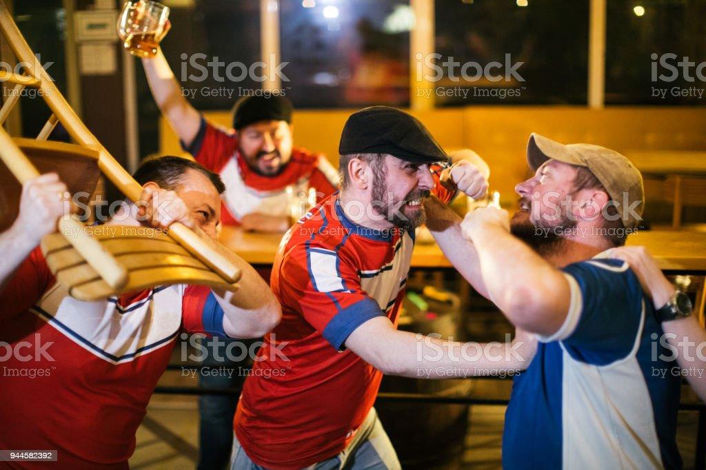 Sport fans fight stock photo