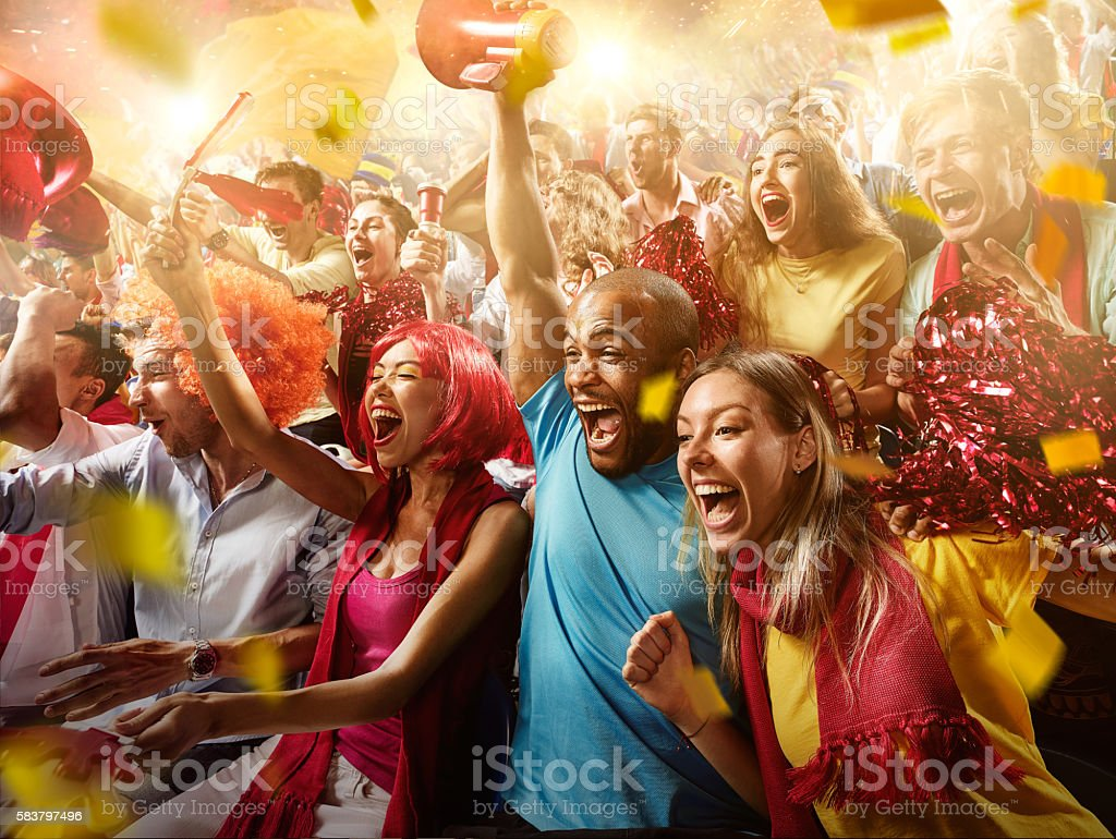 Sport fans: Group of cheering fans stock photo
