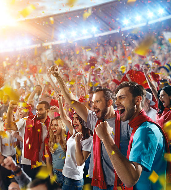 sport fans: happy cheering friends - fan enthusiast stock photos and pictures