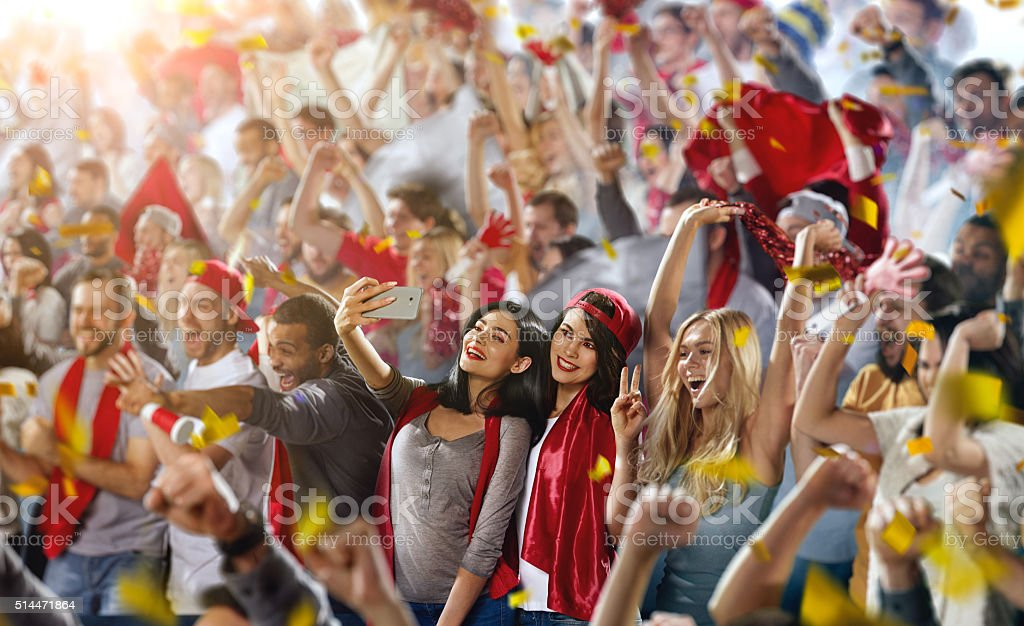 Sport fans: Two female friends stock photo