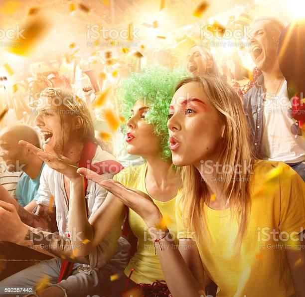 Sport fans two female friends send a kiss picture id592387442?b=1&k=6&m=592387442&s=612x612&h=58gvf0qfdaqtw 3xay7lv8bhbmdpashfxx bknnc3yw=