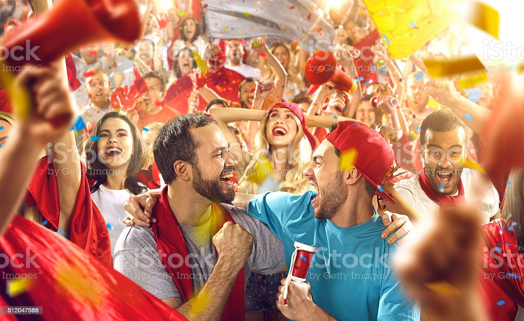 Sport fans: Two friends shouting stock photo
