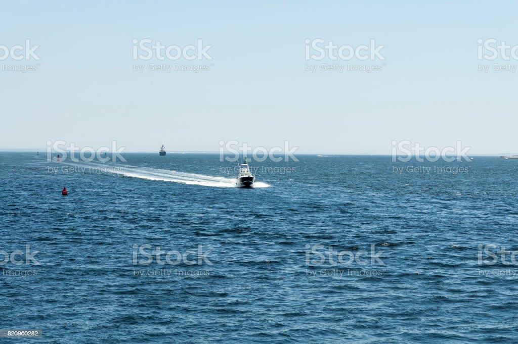Sport fishing boat approaching port stock photo