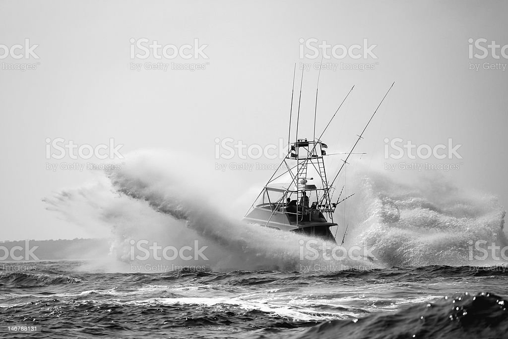 Sport Fishing Boat Crashing Through Waves stock photo