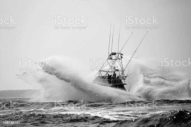 Photo of Sport Fishing Boat Crashing Through Waves