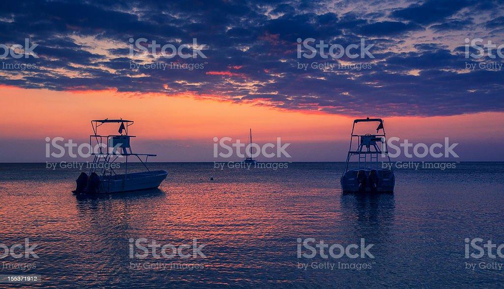 sport fishing motor boats at sunset royalty-free stock photo
