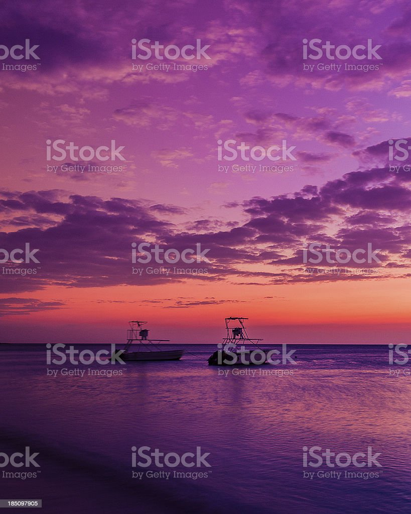 sport fishing motor boats at sunset stock photo