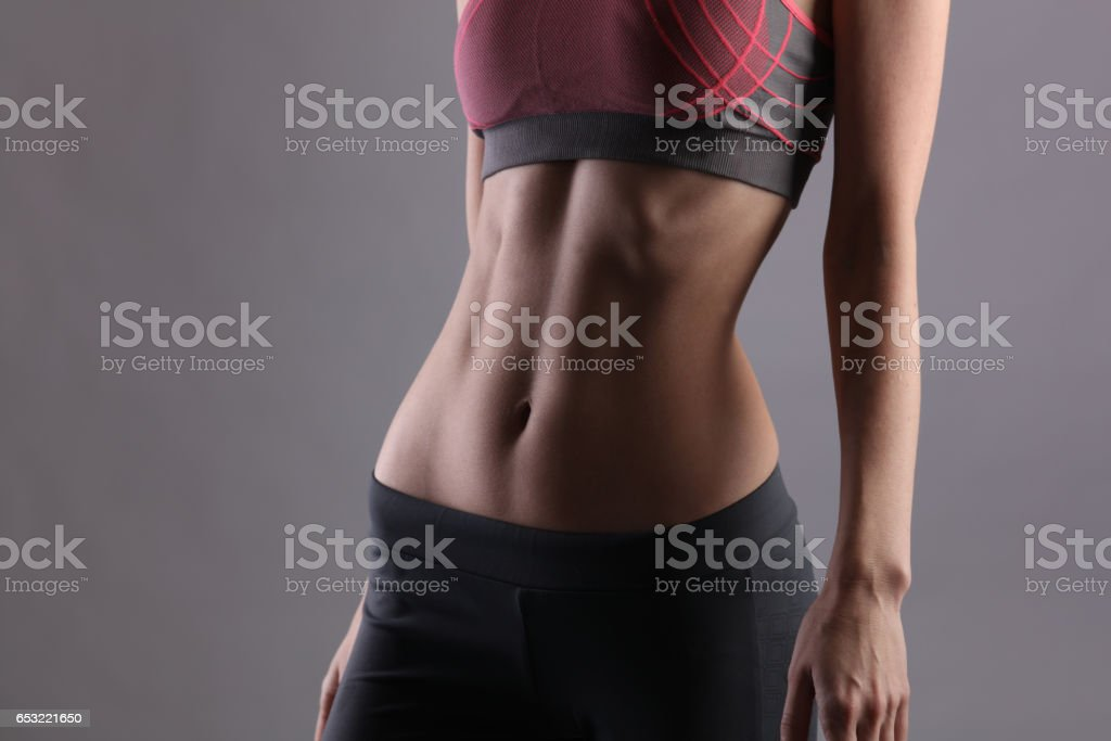 Sport Fit Woman Showing Perfect Abdomen Muscles Slim Body Shape Dieting Fitness Active Lifestyle Concept Copy Space Stock Photo Download Image Now Istock Drapes loosely on the body. sport fit woman showing perfect abdomen muscles slim body shape dieting fitness active lifestyle concept copy space stock photo download image now istock