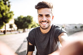 istock sport fitness man take a selfie in the city 1047610012