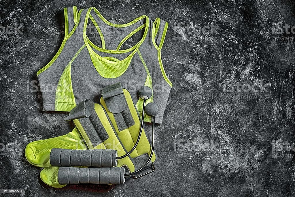 Sport fitness wear and equipment on the texture black background stock photo