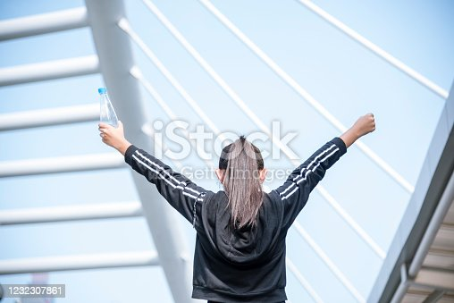 930998708 istock photo Sport Fitness Women drinking mineral water after running exercise modern city wear wellness sportswear outside. Young woman workout outdoor exercising outside. Healthy wellness lifestyle woman concept 1232307861